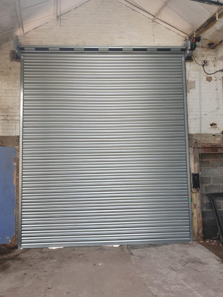 2 x galvanised industrial roller shutter doors. Electrically operated via 3 phase motor and push button operation.