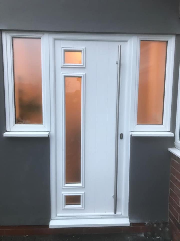 Solidor, rimini design front door in white with a matching frame. This door includes a long bar handle finished with satin glass.