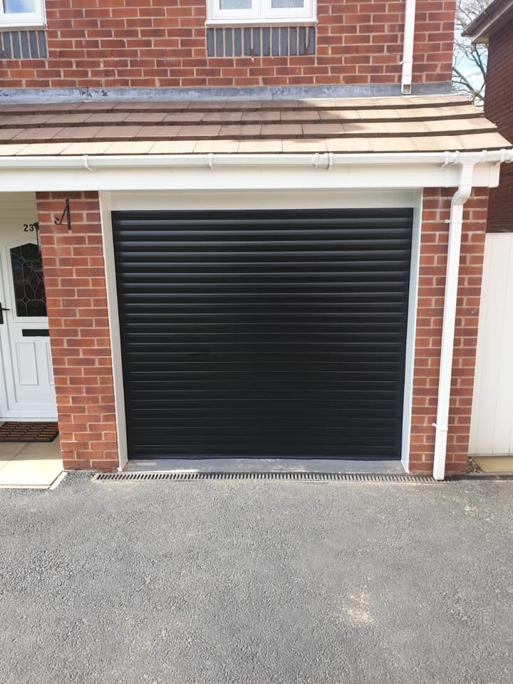 1 x 77mm electrically operated stylish roller door in black with a white kit