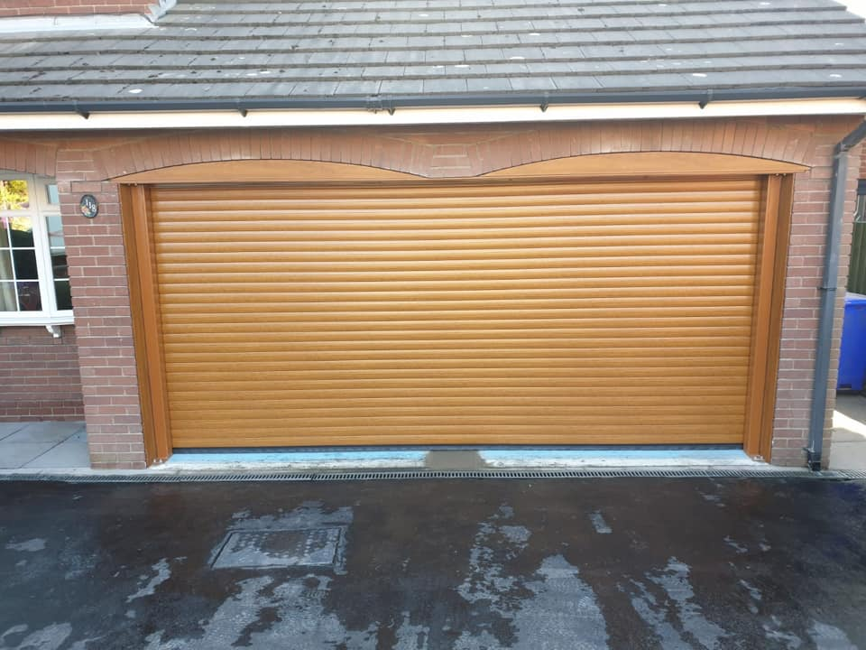 77mm double Stylish roller door in golden oak with a matching kit. This door comes complete with 2 x remote controls