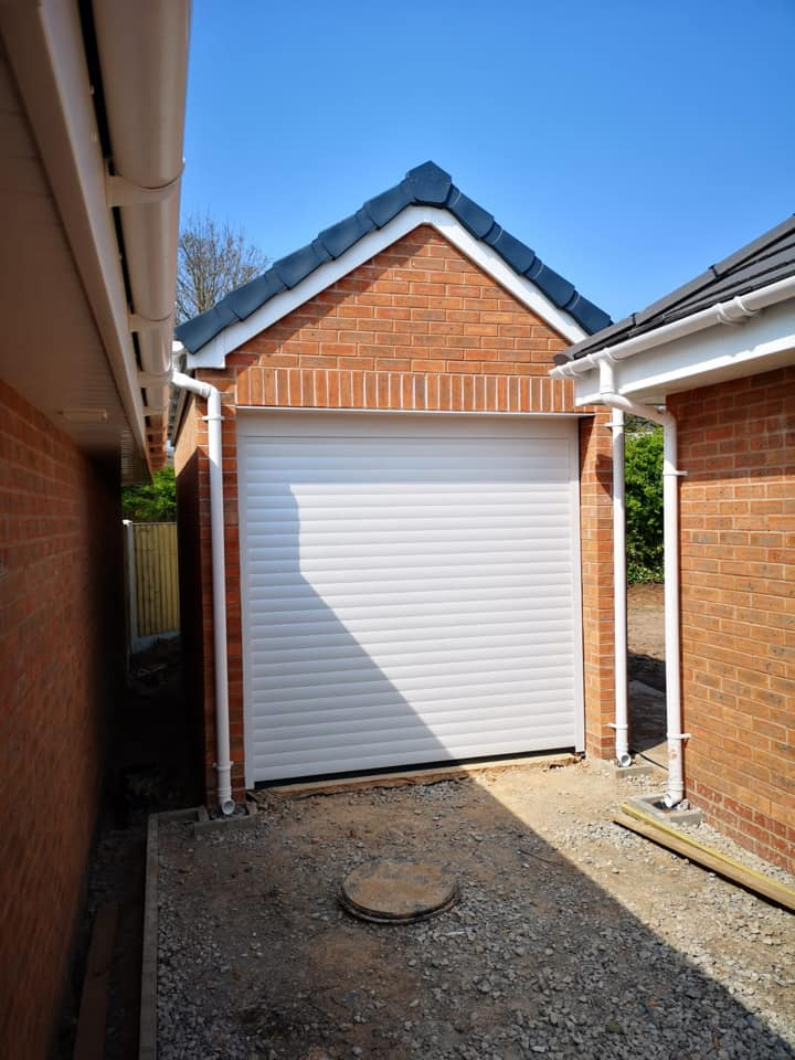77mm Stylish roller door in white with a matching white kit, complete with 2 x remote controls