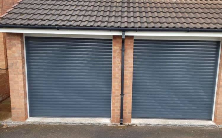 Electrically operated 77mm Stylish roller door in Anthracite Grey with White kits.