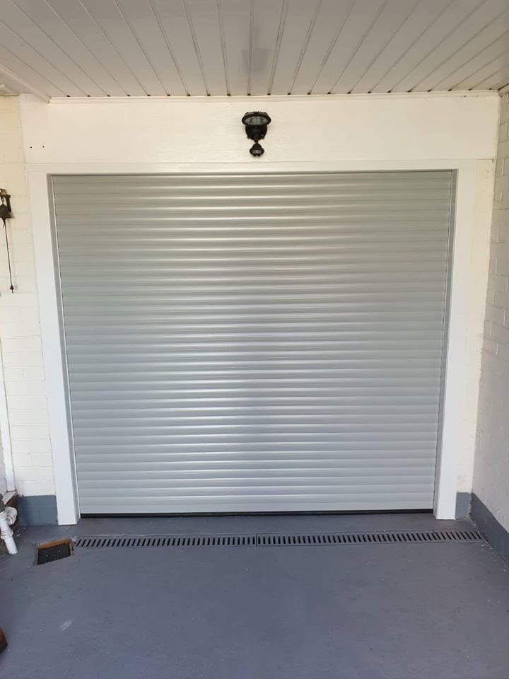77mm Stylish Roller door in Light Grey with a White Kit, complete with 3 x Remote units.