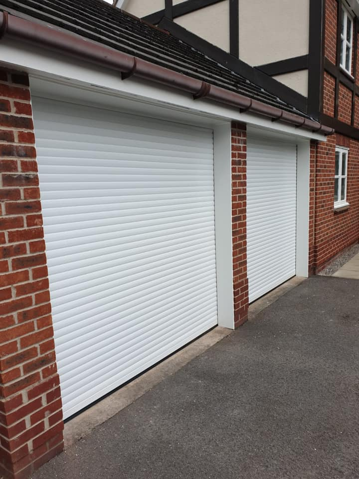 2 x 55mm Insulated stylish roller door in white with a matching white kit complete with 2 x remote controls.