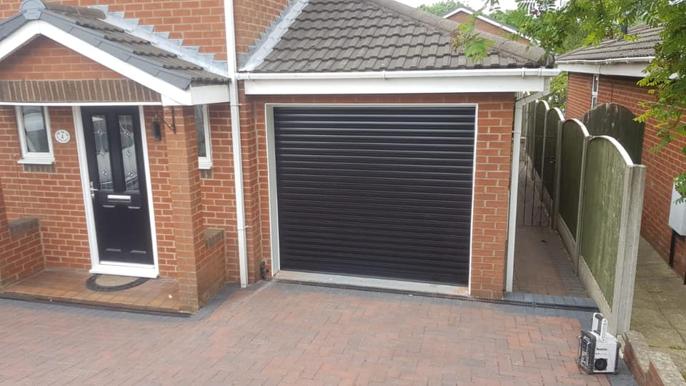 Stylish roller door in Black with White kit complete with 2 remote controls