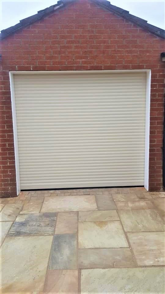 A 55mm Stylish roller door in light beige with a white kit, complete with 2 x remote controls.