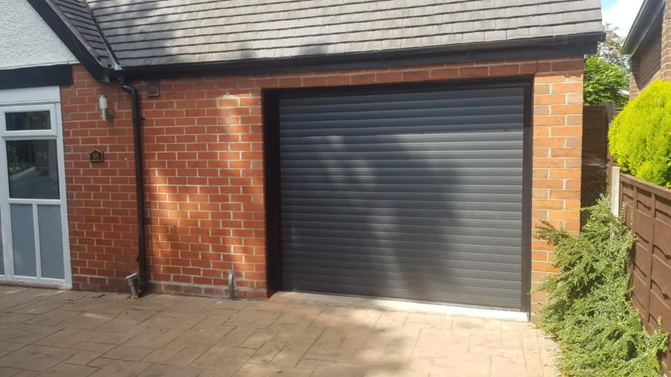 77mm electrically operated stylish roller door in graphite with a black kit. Complete with 2 remotes.