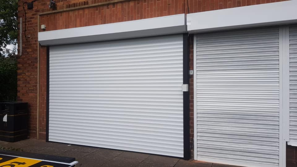 77mm insulated stylish roller shutter in white with a matching kit and black guides. Electrically operated via key switch operation, complete with a lockable key switch box.