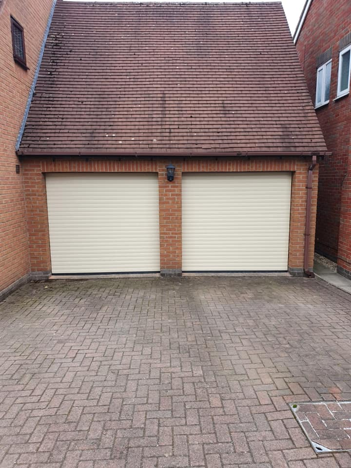 2 x 77mm electrically operated stylish roller doors in ivory with brown kits. Door 1 is operated via rocker switch and door 2 is operated via remote unit.