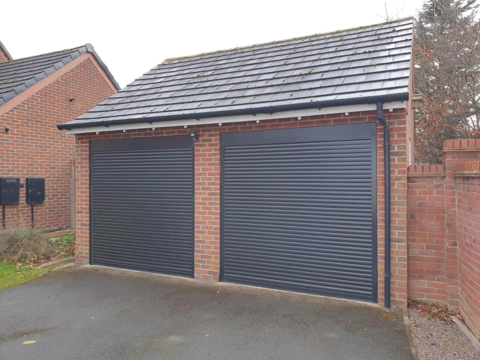 2 x 55mm stylish roller doors in black with matching kits. Both doors are electrically operated via tubular door motors.