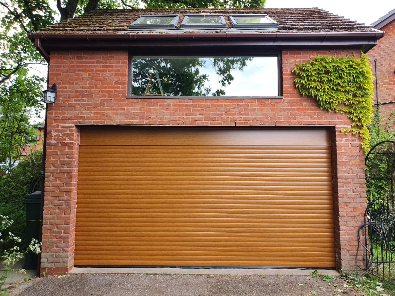 77mm fully insulated double roller garage door in Golden Oak with a matching kit.