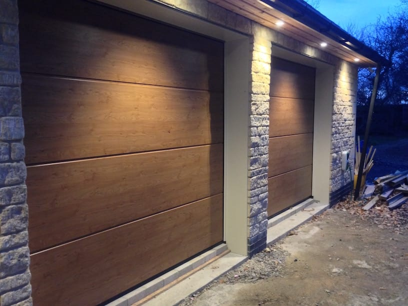2 x L-ribbed sectional garage doors in the Winchester Oak design, complete with 4 x remote controls