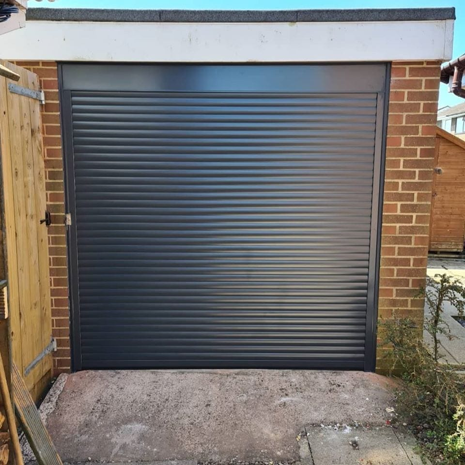 55mm electrically operated and insulated roller garage door in anthracite grey with a matching kit.