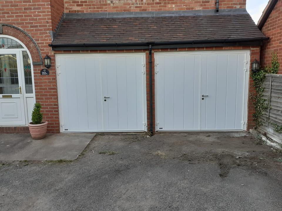 2 x Teckentrup, manually operated and fully insulated side hinged garage doors in a 50/50 split, powder coated white to finish.